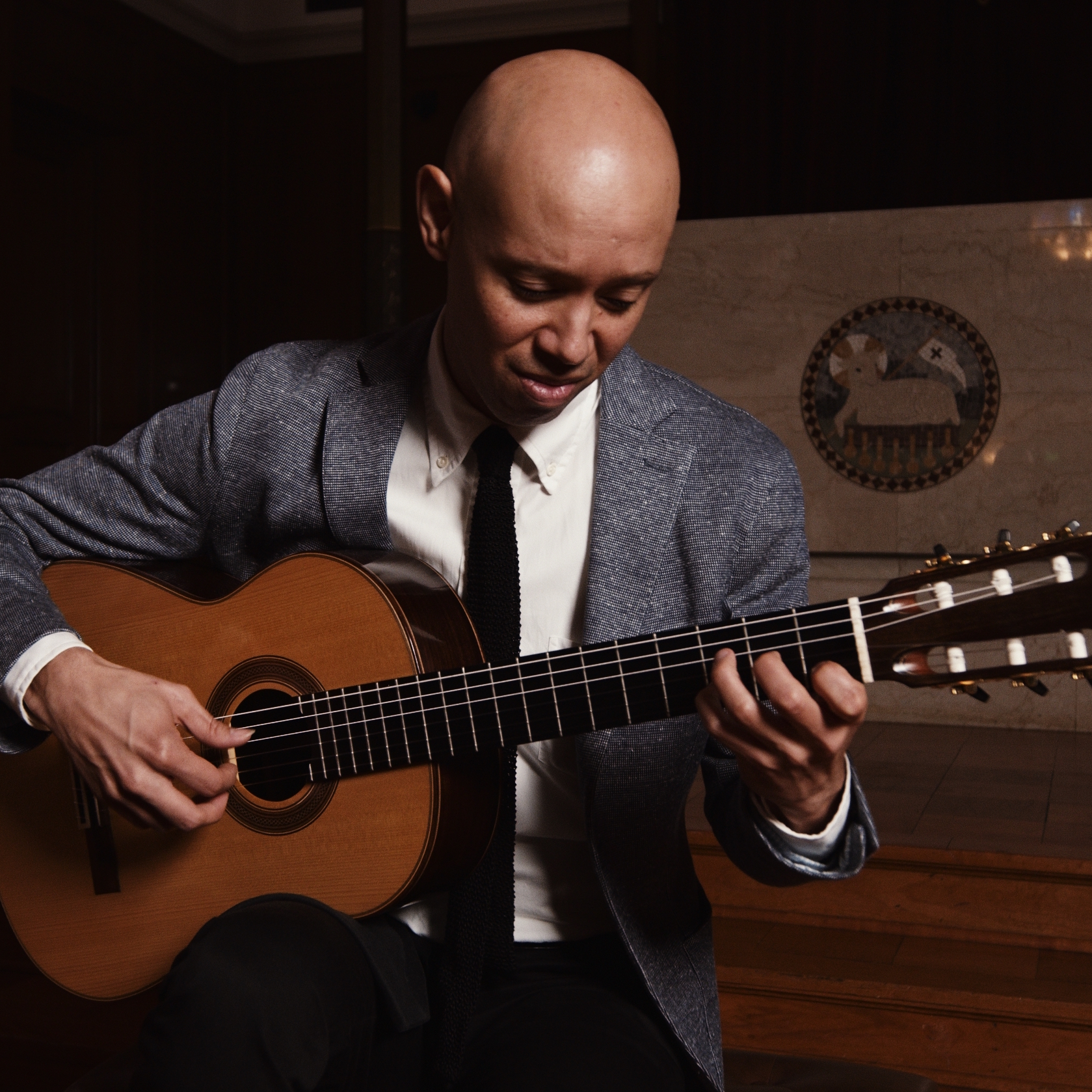 A photo of Philip Graulty playing the guitar.